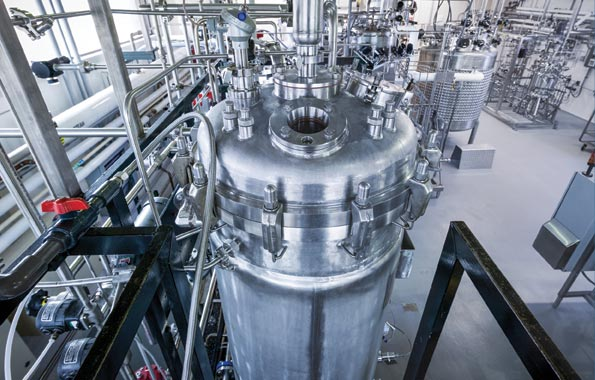 Large volume reagent manufacturing for biotech