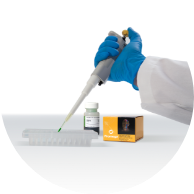 Scientist pipetting a tray